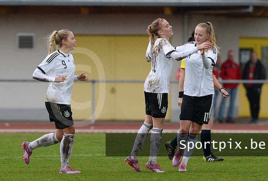 20150404 - FORST , GERMANY  : German Laura Freigang (10)  pictured celebarting her goal for Germany with teammates Nina Ehegotz (9) and Lea Schuller (right) during the soccer match between Women Under 19 teams of Germany and Scotland , on the first matchday in group 5 of the UEFA Elite Round Women Under 19 at WaldseeStadion , Forst , Germany . Saturday 4th April 2015 . PHOTO DAVID CATRY
