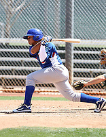 "Oliver ""Junior"" Zapata of the Chicago Cubs plays in an extended spring training game against the Oakland Athletics at the Cubs complex on April 15, 2011  in Mesa, Arizona. .Photo by:  Bill Mitchell/Four Seam Images."