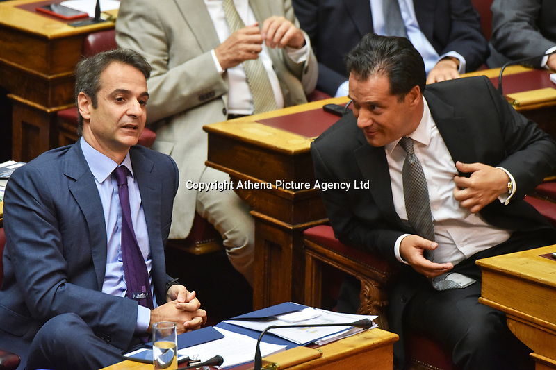 """Pictured: Adonis Georgiadis (R), deputy leader of the New Democracy party with the party leader Kyriakos Mitsotakis (L) in the Greek Parliament. STOCK PICTURE<br />Re: New Democracy vice president Adonis Georgiadis said that a letter bomb sent in his name to German Finance Minister Wolfgang Schaeuble  proved that the Greek postal service (ELTA) is in """"shambles.""""<br />Georgiadis said that """"the envelope was eventually stopped at a place where serious inspections are carried out, proving that ELTA and all the other services it went through are in shambles.""""<br />The parcel addressed to Schaeuble and labeled as being sent by Georgiadis was intercepted at the German Finance Ministry. Bomb experts found that it contained an explosive material similar to that used in fireworks, which could have caused serious injuries if the parcel had been opened."""