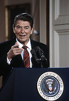 Washington DC., USA, May 22, 1984<br /> President Ronald Reagan during his news conference President Ronald Reagan points to reporter who gets the next question. Credit: Mark Reinstein/MediaPunch