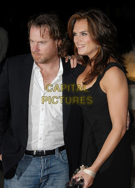 CHRIS HENCHY & BROOKE SHIELDS.The FX Season 4 Premiere Screening of Nip/Tuck held at The Paramount Studios in Hollywood, California, USA..August 25th, 2006.Ref: DVS.Nip Tuck half length black dress husband wife married.www.capitalpictures.com.sales@capitalpictures.com.©Debbie VanStory/Capital Pictures