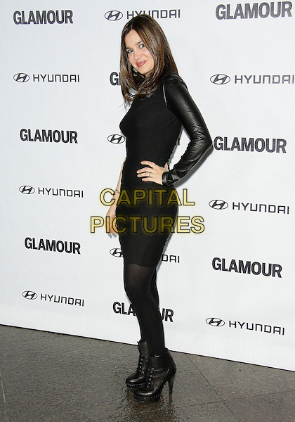 GINA PHILIPS.The Glamour Reel Moments Presented by Hyundai held at The Directors Guild of America in West Hollywood, California, USA..October 25th 2010..full length black one shoulder sleeve dress tights ankle boots hand on hip side .CAP/ADM/TC.©T. Conrad/AdMedia/Capital Pictures.