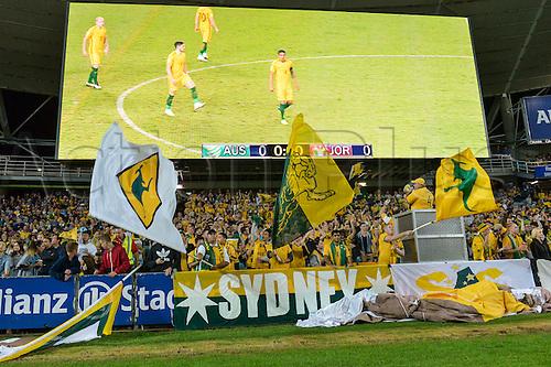 29.03.2016. Allianz Stadium, Sydney, Australia. Football 2018 World Cup Qualification match Australia versus Jordan. Australian fans in front of a huge replay screen. Australia won 5-1.