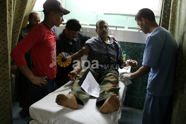 A Palestinian man receives treatment at Al-Shefa'a hospital after he injured by An Israeli tank shell explosion in Gaza city on May 27, 2010.Two Palestinian farmers were wounded when an Israeli tank shell exploded near them as they work in their land after an exchange of fire along the border of the east Gaza Strip, Palestinian medics said. Photo by Ashraf Amra
