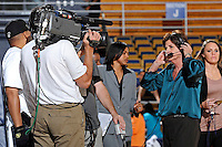 21 January 2012:  FIU Head Coach Cindy Russo is interviewed at the beginning of half-time as part of the telecast of the game as the Florida Atlantic University Owls defeated the FIU Golden Panthers, 50-49, at the U.S. Century Bank Arena in Miami, Florida.