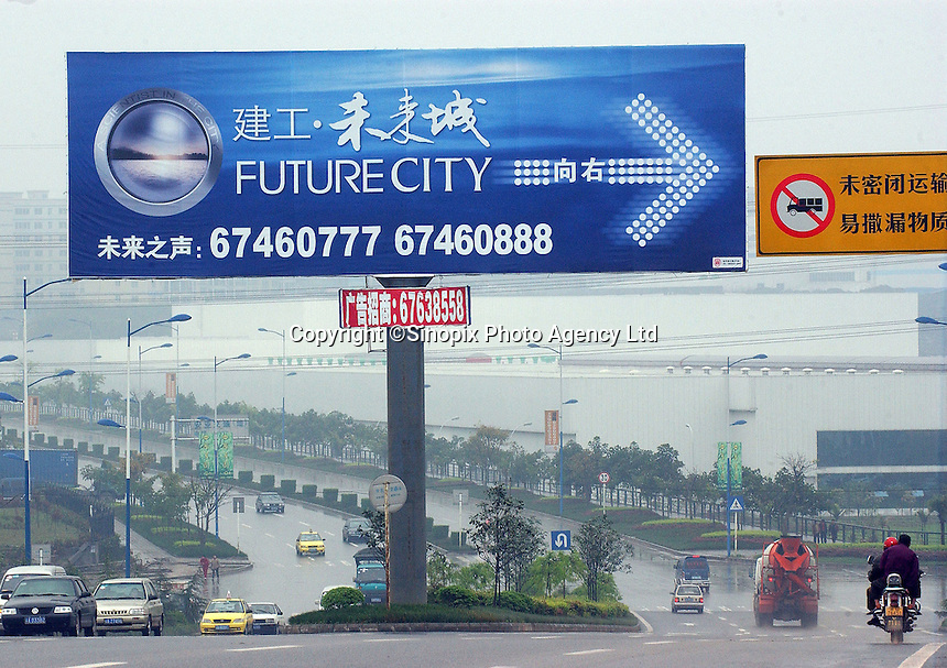 """A road sign shows the way to the """"Future City"""" in Chongqing. Chongqing, the countries largest city and the gateway to western China, is undergoing an astounding building spree and being transformed from an old-style in-land city to a megalopolis..12-APR-0"""