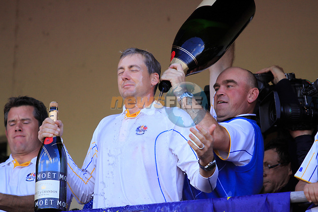 European Team Player Ian Poulter celebrates victory on the clubhouse balcony at the end of The Final Day Monday of the 2010 Ryder Cup at the Celtic Manor Resort. (Photo Manus O'Reilly/Golffile 2010)