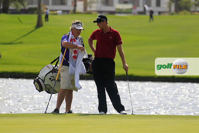 Nicolas Colsaerts (BEL) and Peter Lawrie's cady Bo chat on the 16th green during Saturday's rain delayed Round 3 of the Open de Espana at Real Club de Golf de Sevilla, Seville, Spain, 5th May 2012 (Photo Eoin Clarke/www.golffile.ie)