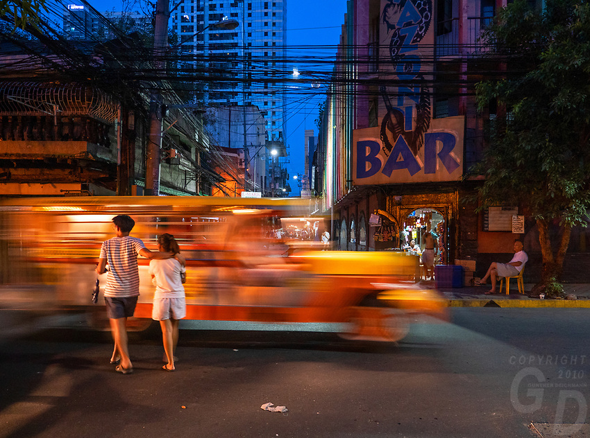 General life and environs in the Malate, Manila area and Manila Bay, Philippines. Jeepney at night . Manila, Philippines