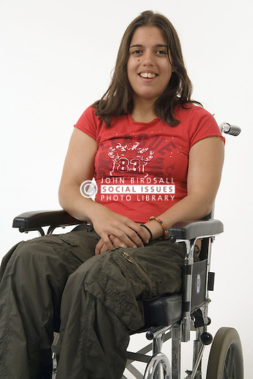 Young woman with Cerebral Palsy in a wheel chair; smiling,