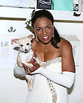 "Audra McDonald and Roxie backstage at ""Lady Day At Emerson's Bar And Grill"" celebrating 100  Broadway Performances  at Circle in the Square on July 2, 2014 in New York City."