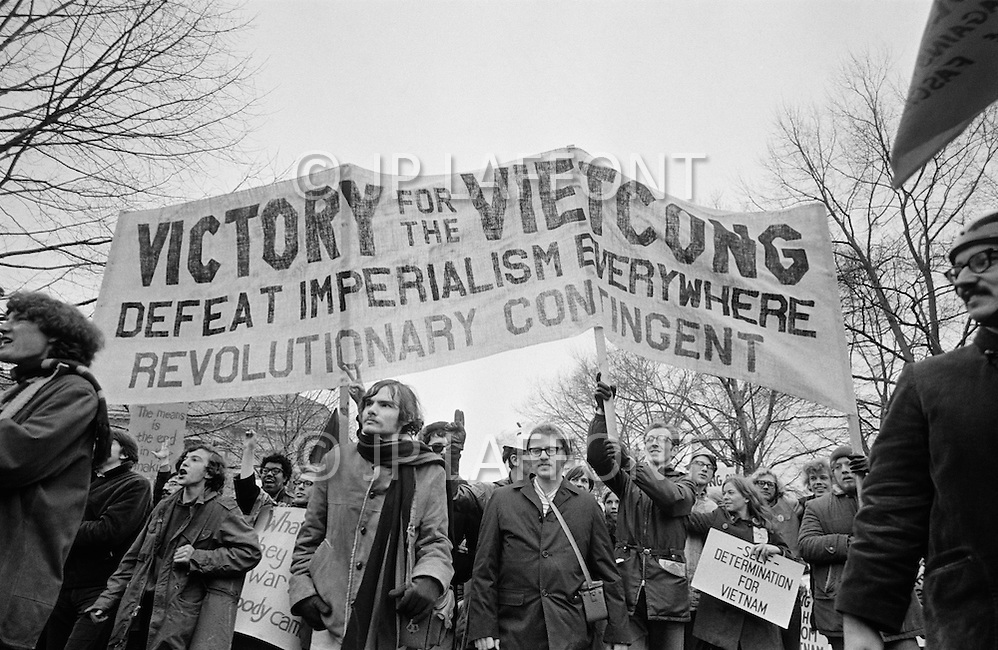 08 Apr 1969 --- Demonstrators in New York City protesting the Vietnam War, which as of this month has claimed more soldiers' lives than that of the entire Korean War. Last month, the United States began secret bombing campaigns of North Vietnamese and Vietcong bases in Cambodia. <br />