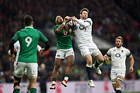 Bundee Aki of Ireland and Elliot Daly of England compete for the ball in the air. Natwest 6 Nations match between England and Ireland on March 17, 2018 at Twickenham Stadium in London, England. Photo by: Patrick Khachfe / Onside Images