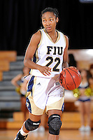 25 February 2012:  FIU guard Jerica Coley (22) handles the ball in the second half as the FIU Golden Panthers defeated the University of South Alabama Jaguars, 58-55 (OT), at the U.S. Century Bank Arena in Miami, Florida.  Coley scored 25 points, and is currently the third leading scorer in NCAA Division I basketball.