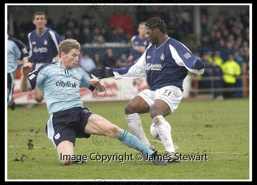 01/02/2003                   Copyright Pic : James Stewart.File Name : stewart-falkirk v st john 03.DARREN DODS CHALLENGES COLLIN SAMUEL.....James Stewart Photo Agency, 19 Carronlea Drive, Falkirk. FK2 8DN      Vat Reg No. 607 6932 25.Office     : +44 (0)1324 570906     .Mobile  : +44 (0)7721 416997.Fax         :  +44 (0)1324 570906.E-mail  :  jim@jspa.co.uk.If you require further information then contact Jim Stewart on any of the numbers above.........