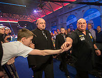 20.12.2014.  London, England.  William Hill World Darts Championship.  Andy Smith (28) [ENG] makes his way to the stage before his match against Ronny Huybrechts [BEL].