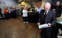 NWA Media/ J.T. Wampler - Bob Goodwin gets a round of applause Thursday Dec. 18, 2014 during a reception for the retiring Rogers City Councilman. Goodwin served on the council for 29 years.