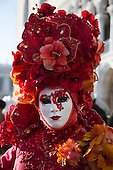 Venice, Italy, 8 February 2015. Woman with a large red headdress. People wear traditional masks and costumes to celebrate the 2015 Carnival in Venice. carnivalpix/Alamy Live News