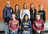 The Newsday All-Long Island varsity girls cross country team poses for a group  photo shoot at company headquarters on Tuesday, Dec. 6, 2016. Appearing are, FRONT ROW, FROM LEFT: Noreen Guilfoyle - Mount Sinai, Katherine Lee - Shoreham-Wading River and Bridget Kanaley - Bay Shore. BACK ROW, FROM LEFT: Coach Paul Koretzki - Shoreham-Wading River, Reilly Siebert - Syosset, Taylor McClay - Eastport-South Manor, Rachel Ruggiero - Sachem East and Brianna O'Brien - Wheatley.