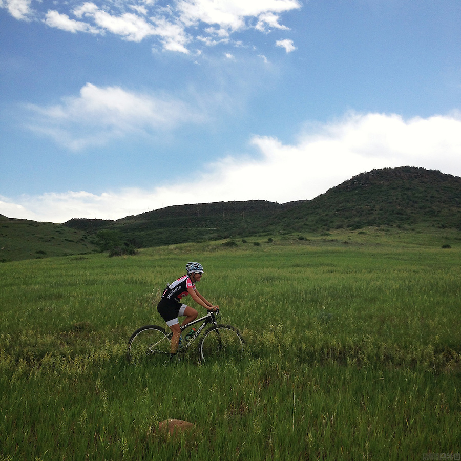 A lone mountain biker traverses North Table Mountain, a mesa in Golden, Colorado.