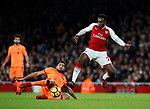Arsenal's Danny Welbeck tussles with Liverpool's Emre Can during the premier league match at the Emirates Stadium, London. Picture date 22nd December 2017. Picture credit should read: David Klein/Sportimage