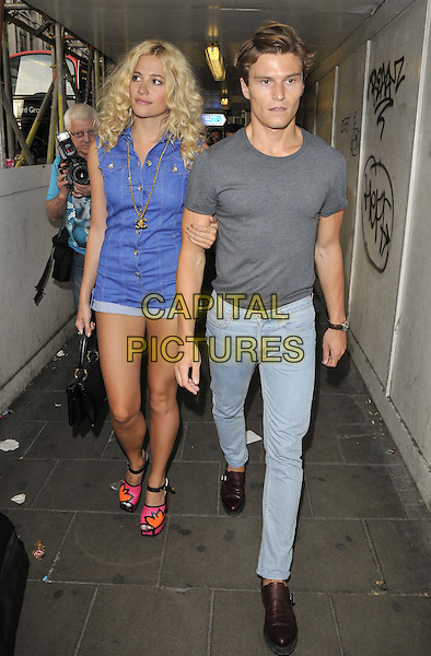 LONDON, ENGLAND - JULY 16: Victoria Louise &quot;Pixie&quot; Lott &amp; Oliver Cheshire attend the Attitude Magazine's World Sexiest Men 2014 summer party, The Paramount Club, 31st floor, Centre Point, New Oxford St., on Wednesday July 16, 2014 in London, England, UK.<br /> CAP/CAN<br /> &copy;Can Nguyen/Capital Pictures