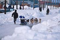 J Alcina Runs Behind Sled @ Shaktoolik 2000 Iditarod AK