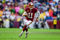 Landover, MD - September 23, 2018: Washington Redskins quarterback Alex Smith (11) rolls out of the pocket and picks up a first down late in the 4th quarter of game between the Green Bay Packers and the Washington Redskins at FedEx Field in Landover, MD. The Redskins get the win 31-17 over the visiting Packers. (Photo by Phillip Peters/Media Images International)