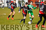 Sean McElligott of St Brendans Park under pressure from Killarneys Mark Daly in the John Joe Naughton U13's Cup game, in Christy Leahy Park on Saturday last.