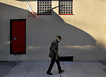 A man with cane walks down Green Street in Northbeach near Grant Street in San Francisco, CA..