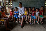 Teacher Lodema Dela Cruz Doroteo talks with children in a class in Santa Ines, an indigenous village in the Philippines. A graduate of Harris Memorial College, where she benefited from a scholarship from United Methodist Women, she is the first indigenous school teacher in her village.