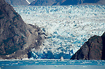 Alaska, Tracy Arm, Luxury Cruise Ships dwarfed at the blue-ice face of the Sawyer Glacier, Southeast Alaska, USA, North America,.