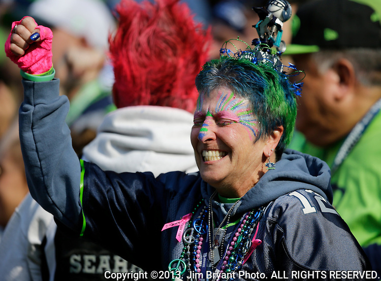 Seattle Seahawks fans cheer against the Tennessee Titans at CenturyLink Field in Seattle, Washington on  October13, 2013.  The Seahawks beat the Titians 20-13. ©2013 Jim Bryant Photo. ALL RIGHTS RESERVED.