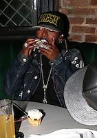 NEW YORK, NY - JULY 11, 2016 Missy Elliot snacks on birthday cupcakes at LiL Kim's private birthday party at the Jue Lan Club July 11, 2016 in New York City. Photo Credit: Walik Goshorn / Mediapunch