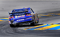 Jun. 21, 2009; Sonoma, CA, USA; NASCAR Sprint Cup Series driver Patrick Carpentier hits the curb in turn four during the SaveMart 350 at Infineon Raceway. Mandatory Credit: Mark J. Rebilas-
