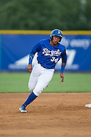 Xavier Fernandez (34) of the Burlington Royals hustles towards third base against the Danville Braves at Burlington Athletic Park on July 12, 2015 in Burlington, North Carolina.  The Royals defeated the Braves 9-3. (Brian Westerholt/Four Seam Images)