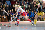 Mannheim, Germany, January 24: During the 1. Bundesliga Damen Hallensaison 2014/15 quarter-final hockey match between Mannheimer HC (white) and Harvestehuder THC (black) on January 24, 2015 at Irma-Roechling-Halle in Mannheim, Germany. Final score 2-3 (2-2). (Photo by Dirk Markgraf / www.265-images.com) *** Local caption ***
