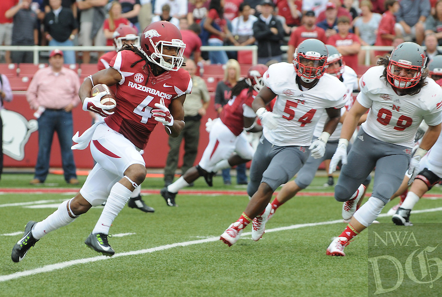 STAFF PHOTO ANTHONY REYES • @NWATONYR<br /> Keon Hatcher Razorbacks wide receiver outruns Nicholls State defends for an opening drive touchdown in the first quarter Saturday, Sept. 6, 2014 at Razorback Stadium in Fayetteville.