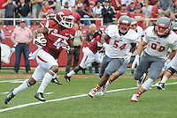 STAFF PHOTO ANTHONY REYES &bull; @NWATONYR<br /> Keon Hatcher Razorbacks wide receiver outruns Nicholls State defends for an opening drive touchdown in the first quarter Saturday, Sept. 6, 2014 at Razorback Stadium in Fayetteville.