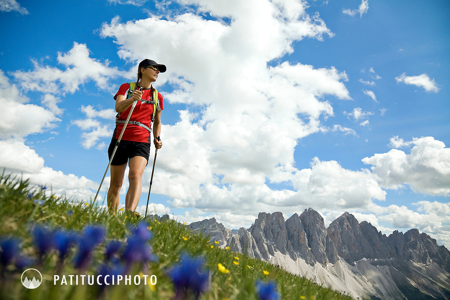 Janine Patitucci hiking in the Villnosstal near the Passo delle Erbe. The area is famous for being the valley where Reinhold Messner was born and raised. Janine is hiking the Gunther Messner Höhenweg which traverses the area around the Geislergruppe