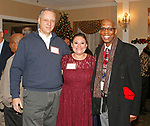 Waterbury, CT 120717MK15 Dave Martin, Kara Merra and Maurice Mosley gathered for the Waterbury Youth Services, Inc. Santa's Workshop at The Country Club of Waterbury. The event helps raise funds to make the holiday season memorable for children in need Michael Kabelka / Republican-American