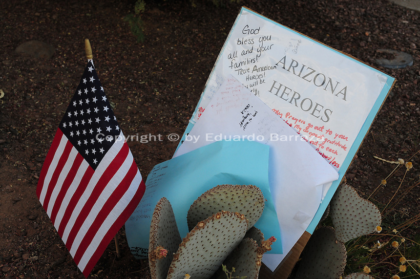 "Phoenix, Arizona. July 3, 2013.  A small makeshift memorial for the 19 Arizona firefighters who died on June 30 battling the Yarnell Hill wildfire was built outside the Forensic Science Center in Phoenix, where autopsies are being conducted. A small American flag and a sign that partially reads: ""Arizona Heroes"" wer placed outside the building in Phoenix where the remains of the 19 firefighters were brought for the autopsies. Photo by Eduardo Barraza © 2013"