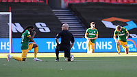 Referee Andy Woolmer and Preston North End's Daniel Johnson bend down for the black lives matter <br /> <br /> Photographer Ian Cook/CameraSport<br /> <br /> The EFL Sky Bet Championship - Bristol City v Preston North End - Wednesday July 22nd 2020 - Ashton Gate Stadium - Bristol <br /> <br /> World Copyright © 2020 CameraSport. All rights reserved. 43 Linden Ave. Countesthorpe. Leicester. England. LE8 5PG - Tel: +44 (0) 116 277 4147 - admin@camerasport.com - www.camerasport.com