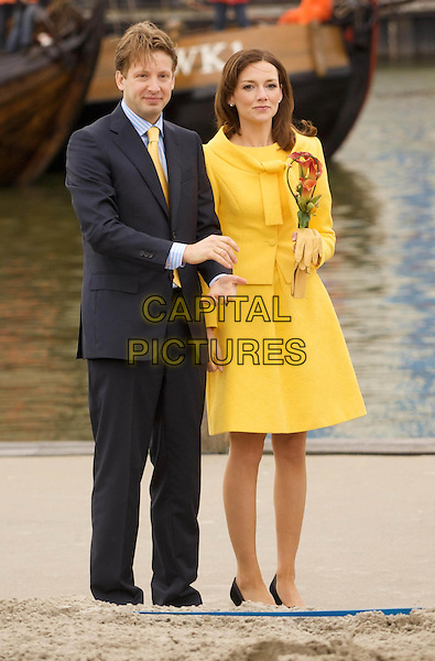 PRINCE FLORIS & AIMEE SOHNGEN.Prince Floris and Princess Aimee celebrate the arrival of their second daughter..Queen in Friesland / Netherlands, community Makkum and Franeker..April 30th, 2008.full length married husband wife couple black suit yellow dress .CAP/PPG/JH.©Jens Hartmann/People Picture/Capital Pictures