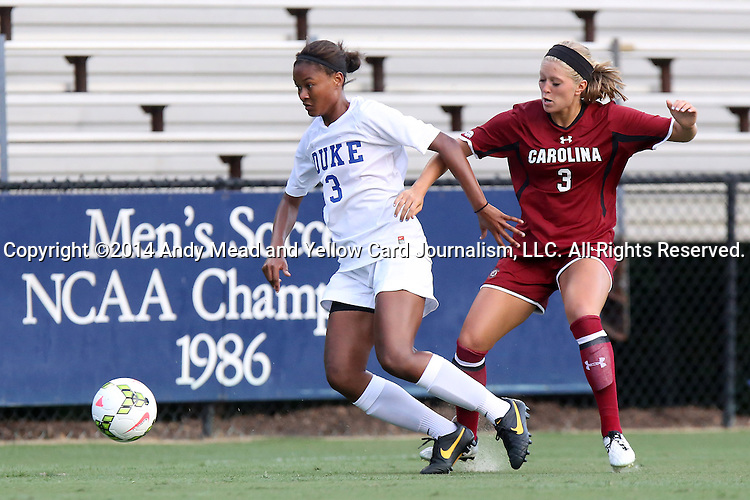 14 August 2014: Duke's Imani Dorsey (left) and South Carolina's Caroline Gray (right). The Duke University Blue Devils hosted the University of South Carolina Gamecocks at Koskinen Stadium in Durham, NC in a 2014 NCAA Division I Women's Soccer preseason match. Duke won the exhibition 2-0.