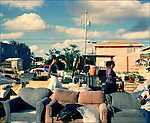 At 62nd Street and 17th Avenue in Miami liesUmoja Village. It is on the west side of I-95. Max Rameau a community leader built the shanty town in response to the county housing scandal where developers were stealing millions of dollars earmarked for affordable housing. Over 60 people are living in the village made up of pallets and old sofa's. Among the residents is Gypsy Bird a homeless poet.