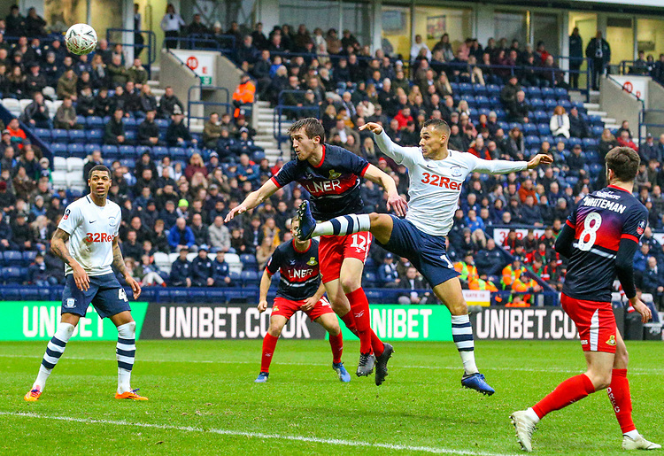 Preston North End's Graham Burke heads at goal under pressure from Doncaster Rovers' Tom Anderson<br /> <br /> Photographer Alex Dodd/CameraSport<br /> <br /> The Emirates FA Cup Third Round - Preston North End v Doncaster Rovers - Sunday 6th January 2019 - Deepdale Stadium - Preston<br />  <br /> World Copyright © 2019 CameraSport. All rights reserved. 43 Linden Ave. Countesthorpe. Leicester. England. LE8 5PG - Tel: +44 (0) 116 277 4147 - admin@camerasport.com - www.camerasport.com