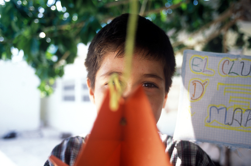 A boy at a crisis center in Cancún for women and children who have been victims of violence run by Lydia Cacho. She has been receiving death threats for eight years but is undaunted. May 25, 2005.  Cancun, Mexico.