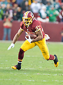 Washington Redskins running back Chris Thompson (37) carries the ball in first quarter action against the Philadelphia Eagles at FedEx Field in Landover, Maryland on Saturday, December 20, 2014.<br /> Credit: Ron Sachs / CNP