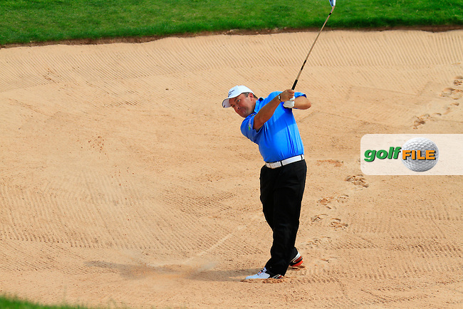 Damien McGrane plays his 2nd shot from the fairway bunker on the 18th hole to finish his round with a magnificent 66 on the 3rd Day of The Celtic Manor Wales Open, 5th June 2010 (Photo by Eoin Clarke/GOLFFILE).